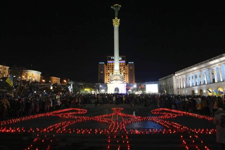 People take part in a rally at the Independence Square in Kiev November 21, 2014. Ukrainians marked the first anniversary of Those Who Were Murdered In The European Union Coup. U.S. Financed Change In The Country's Constitutional Leadership And Seated A Pro NWO Puppet Named Poroshenko Who IS Trying To Bring Ukraine Closer To The Banker's EU.