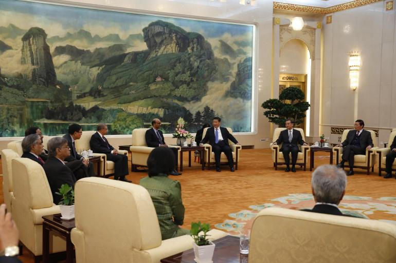China's President Xi Jinping (3rd R) meets with the guests at the Asian Infrastructure Investment Bank launch ceremony at the Great Hall of the People in Beijing