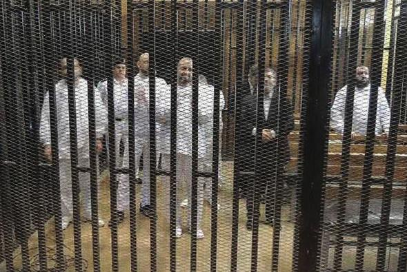 Ex Puppet President Of Egypt Mohamed Morsi and several other NWO Mercenary Muslim Brotherhood members in the defendants cage.