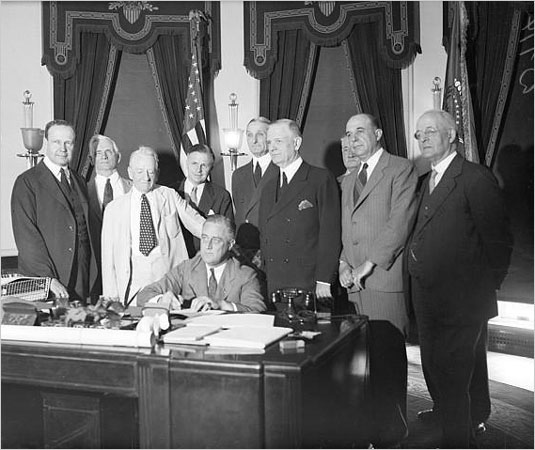 President Roosevelt [FDR] Signing the Glass-Steagall Act July 16, 1933. Preventing Banks From Meddling With The U.S> Economy. Separating Investment From Commercial Banking.