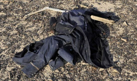 A passenger's clothes lie on the floor at the scene of the crash
