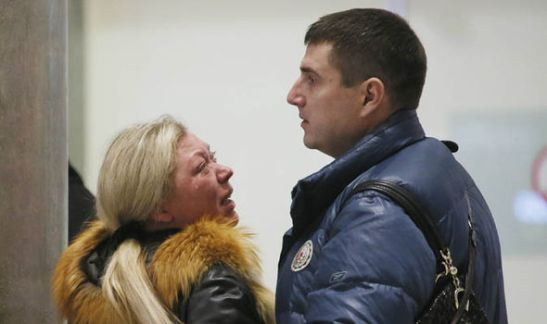 Relatives react after a Russian plane with 217 passengers and seven crew aboard crashed in Egypt