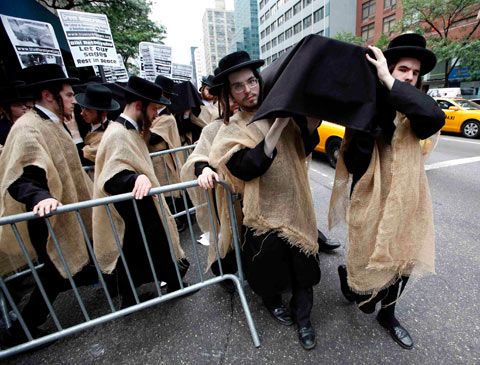 Orthodox Jewish demonstrators carry a mock coffin in protest against the government of Israeloutside the Israeli mission to the United Nations, in New York