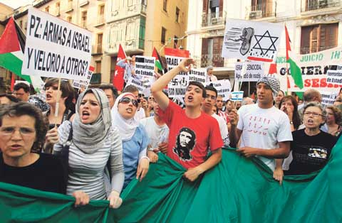 Demonstrators shout slogans during an anti-Israel protest in front of the foreign ministry in Madrid. Israeli marines stormed a Turkish aid ship bound for Gaza on Monday and 10 pro-Palestinian activists were killed, triggering a diplomatic crisis and plans for an emergency session of the U.N. Security Council.