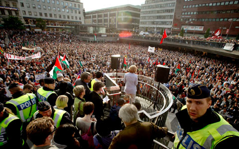 Demonstrators listen to speeches during an anti-Israel protest in downtown Stockholm, Sweden.