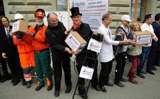 Members of the initiative committee for Monetary Reform (Vollgeld-Initiative) hand over boxes with more than 120,000 signatures at the Federal Chancellery in Bern, Switzerland.