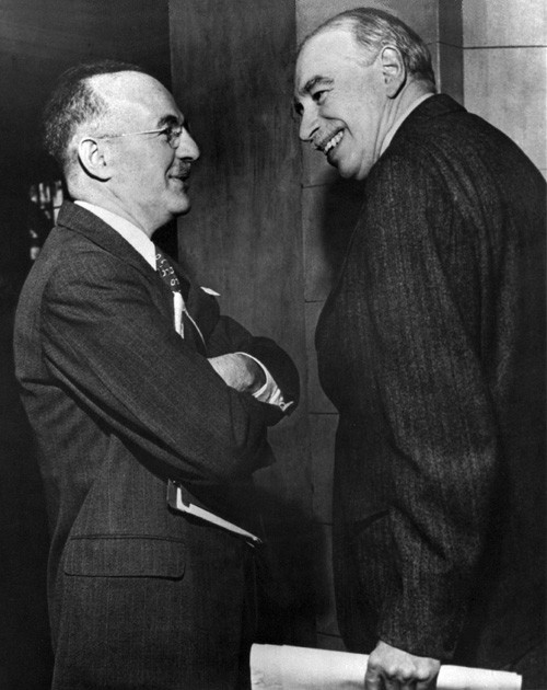Convicted Soviet Spy Harry Dexter White (left) and John Maynard Keynes (right) at the Bretton Woods Conference conspiring Rothschild's Private Federal Reserve 1913.