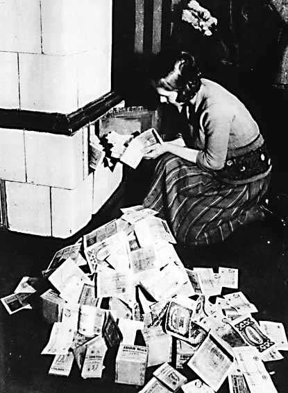 1923 Hyperinflation in Germany: A woman burns German marks in the furnace to heat the home during the peak of the Weimar Germany hyperinflation. The currency had devalued so much, it was cheaper to burn the German mark than to use it to buy coal or firewood. So their currency was more valuable as mere paper (to be burned) than as a money (to be spent).