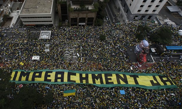 Demonstrators in São Paulo take part in a protest to demand the resignation of Dilma Rousseff. Photograph: Miguel Schincariol/AFP/Getty Images