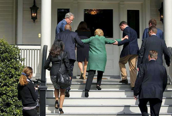 """In this heated presidential race where being """"fit"""" and """"stable"""" have become terms in the arsenal of both campaigns, startling photographs emerged Sunday showing Democratic nominee Hillary Clinton apparently getting help in climbing up some stairs."""