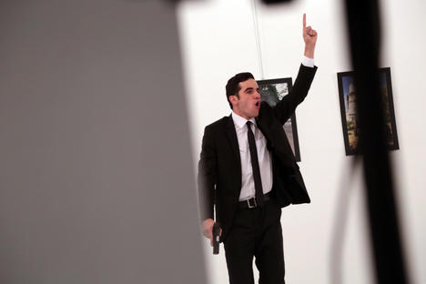 An unnamed gunman gestures after shooting the Russian Ambassador to Turkey, Andrei Karlov, at a photo gallery in Ankara, Turkey, Monday, Dec. 19, 2016. A gunman opened fire on Russia's ambassador to Turkey at a photo exhibition. Source: AP